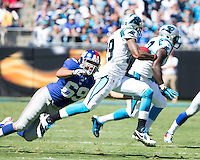 The Carolina Panthers played the New York Giants at Bank of America Stadium in Charlotte, NC.  The Panthers won 38-0 for their first victory of the season.  The Giants dropped to 0-3.New York Giants defensive end Justin Trattou (69), Carolina Panthers wide receiver Ted Ginn (19)