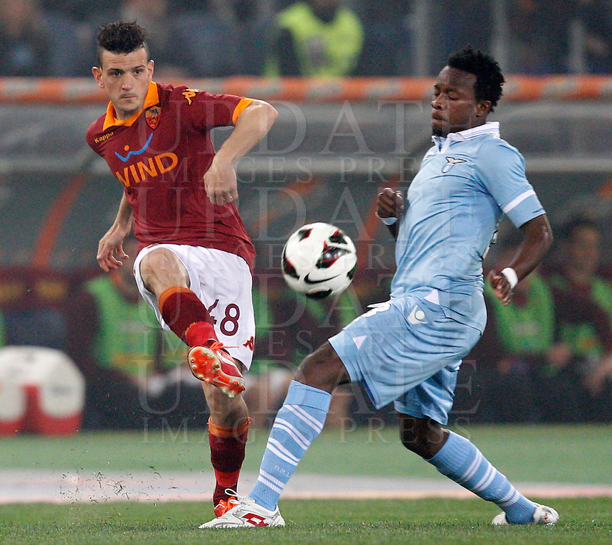 Calcio, Serie A: Roma vs Lazio. Roma, Stadio Olimpico, 8 aprile 2013..AS Roma midfielder Alessandro Florenzi, left, is challenged by Lazio midfielder Ogenyi Onazi, of Nigeria, during the Italian serie A football match between A.S. Roma  and Lazio at Rome's Olympic stadium, 8 april 2013..UPDATE IMAGES PRESS/Riccardo De Luca