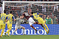ROMA, Italy: October 31, 2013: As Roma beats AC Chievo Verona 1-0 during the Serie A match played in the Olimpico Stadium. In the photo Marco Borriello (R) scoring the decisive goal