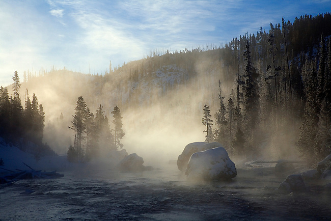 Cold temperatures produce steam from the Firehole River at Yellowstone National Park, Wyoming.