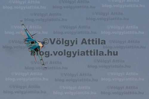 SZU-27 aircrafts of the Russkye Vityazi squadron from the Russian Airforce perform during the International Air Show at the Hungarian Air Force base in Kecskemet (about 87 km South-East of the capital city Budapest), Hungary on August 03, 2013. ATTILA VOLGYI