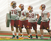 From left to right, offensive linemen Morgan Moses (76) of Virginia, Clint Marsh (74) of Grambling, Trevita Stevens (62) of Utah, and Spencer Long (60) of Nebraska participate in the Washington Redskins' rookie minicamp at Redskins Park in Ashburn, Virginia on Saturday, May 17, 2014.<br /> Credit: Ron Sachs / CNP