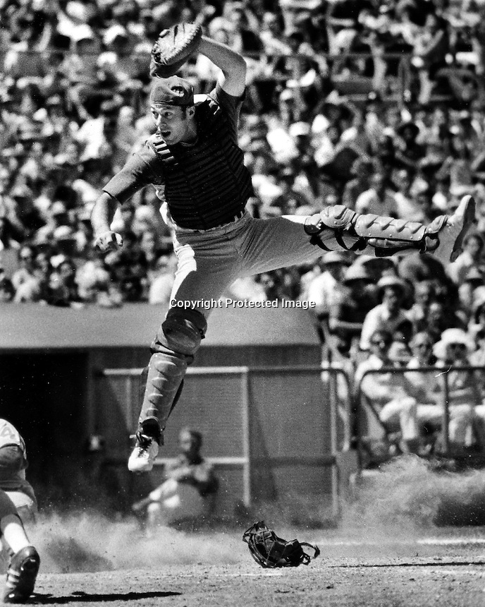 A's catcher Mike Heath leaps for throw. (photo by Ron .Riesterer)