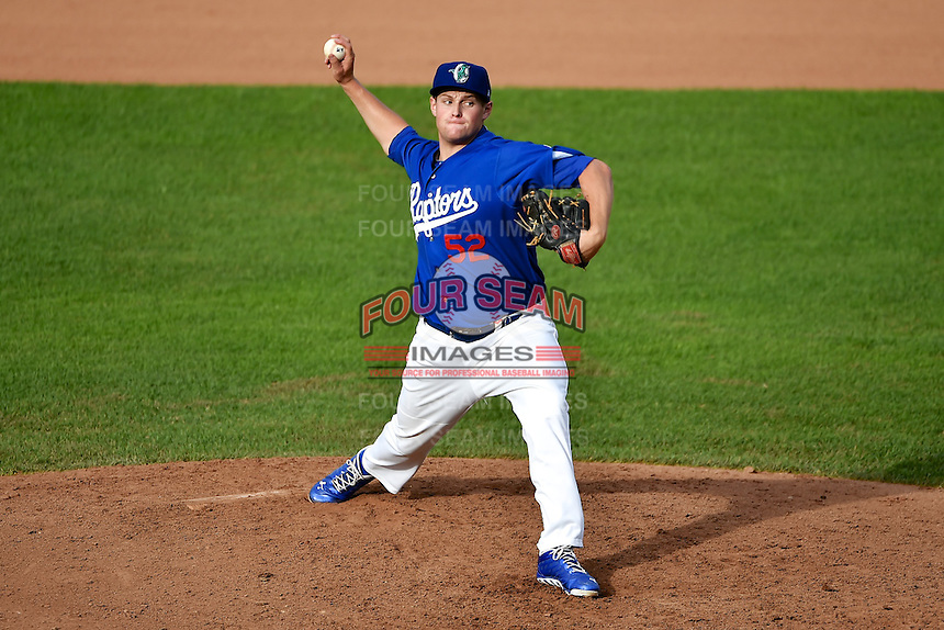 Trevor Oaks (52) of the Ogden Raptors delivers a pitch to the plate against the Orem Owlz in Pioneer League action at Lindquist Field on June 27, 2014 in Ogden, Utah.  (Stephen Smith/Four Seam Images)