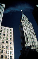 The Chrysler building and surrounding office towers in midtown Manhattan. city, building, power, corporate headquarters, landmark, icon, art deco, steel. New York New York USA.