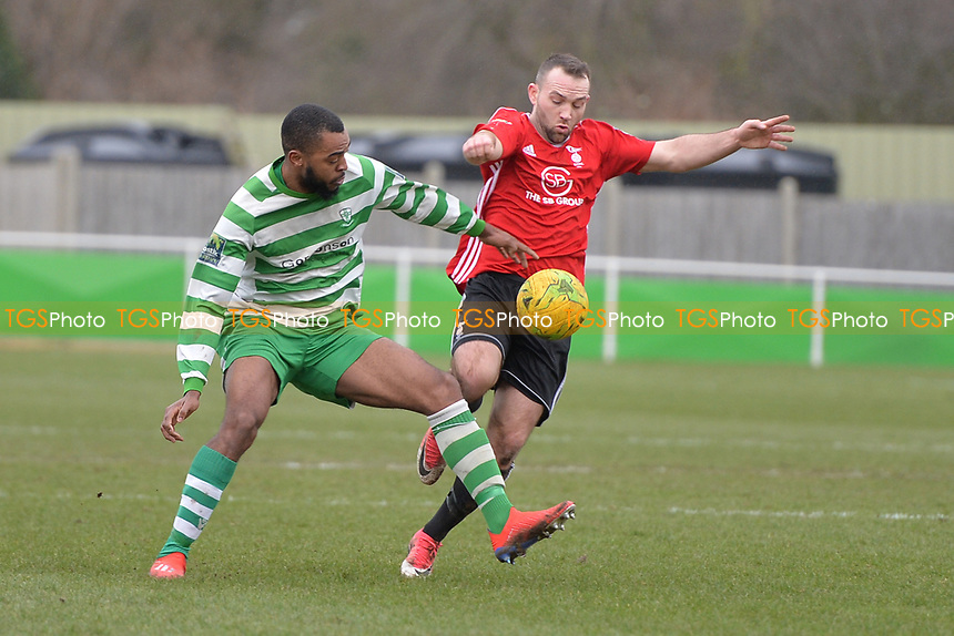 Christian Assombalonga Of Waltham Abbey is tackled during Waltham Abbey vs Bracknell Town, Bostik League South Central Division Football at Capershotts on 9th February 2019