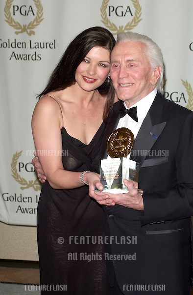 Actress CATHERINE ZETA-JONES with  her father-in-law actor KIRK DOUGLAS at the Producers Guild of America's 12th Annual Golden Laurel Awards in Los Angeles where she presented him with the Milestone Award..03MAR2001.   © Paul Smith/Featureflash