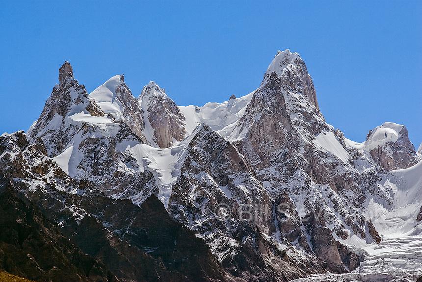 Snow and glacier covered granite spires above the Baltoro glacier in the Karakoram himalaya mountains in Baltistan in Pakistan