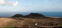 Panoramic view of the volcanic landscape of Lanzarote, Canary Islands, Spain, pictured on November 26, 2010. North east of the island, on the road to Mirador del Rio, the dramatic bare landscape stretches to the clifftops with the Atlantic Ocean in the background. Lanzarote, the Easternmost of the Canary Islands, lies 125km East of the African coast, in the Atlantic Ocean. Like the other islands in this autonomous Spanish archipelago, Lanzarote is originally Volcanic. Picture by Manuel Cohen.