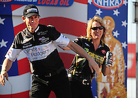 Sept. 6, 2010; Clermont, IN, USA; NHRA pro stock motorcycle rider Steve Johnson (left) jokes with Karen Stoffer during driver introductions prior to the U.S. Nationals at O'Reilly Raceway Park at Indianapolis. Mandatory Credit: Mark J. Rebilas-