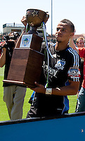 San Jose Earthquakes captain Jason Hernandez holds the inaugural Heritage Cup. The San Jose Earthquakes defeated Seattle Sounders FC 4-0 at Buck Shaw Stadium in Santa Clara, California on August 2, 2009.