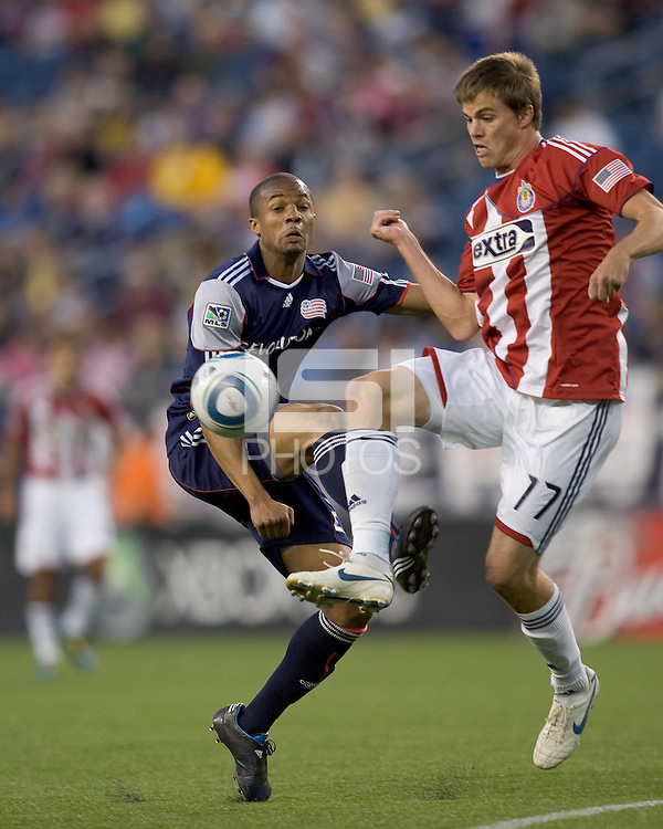 Chivas USA forward Justin Braun (17) attempts to control the ball as New England Revolution defender Darrius Barnes (25) defends. Chivas USA defeated the New England Revolution, 4-0, at Gillette Stadium on May 5, 2010.