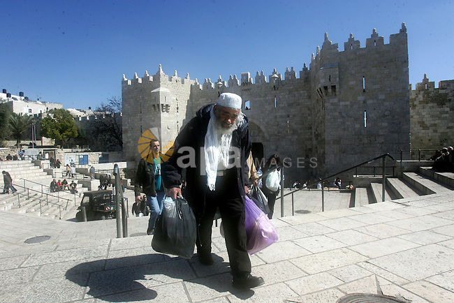 Palestinians walk outside Damascus Gate leading into the old city of Jerusalem on March 6, 2012. Photo by Mahfouz Abu Turk