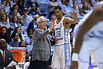 CHAPEL HILL, NC - DECEMBER 03: UNC head coach Roy Williams (left) and Garrison Brooks (15). The University of North Carolina Tar Heels hosted the Tulane University Green Wave on December 3, 2017 at Dean E. Smith Center in Chapel Hill, NC in a Division I men's college basketball game. UNC won the game 97-73.