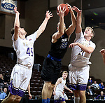 SIOUX FALLS, SD - MARCH 12:  Nate Bruneel #45, left, and Matt Duniphan #21 from the College of Idaho battle for the loose ball with Stephen Turner #22 from St. Francis during their semifinal game at the 2018 NAIA DII Men's Basketball Championship at the Sanford Pentagon in Sioux Falls. (Photo by Dave Eggen/Inertia)