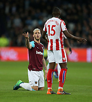 West Ham United's Marko Arnautovic has words with Stoke City's Bruno Martins Indi<br /> <br /> Photographer Rob Newell/CameraSport<br /> <br /> The Premier League - West Ham United v Stoke City - Monday 16th April 2018 - London Stadium - London<br /> <br /> World Copyright &copy; 2018 CameraSport. All rights reserved. 43 Linden Ave. Countesthorpe. Leicester. England. LE8 5PG - Tel: +44 (0) 116 277 4147 - admin@camerasport.com - www.camerasport.com