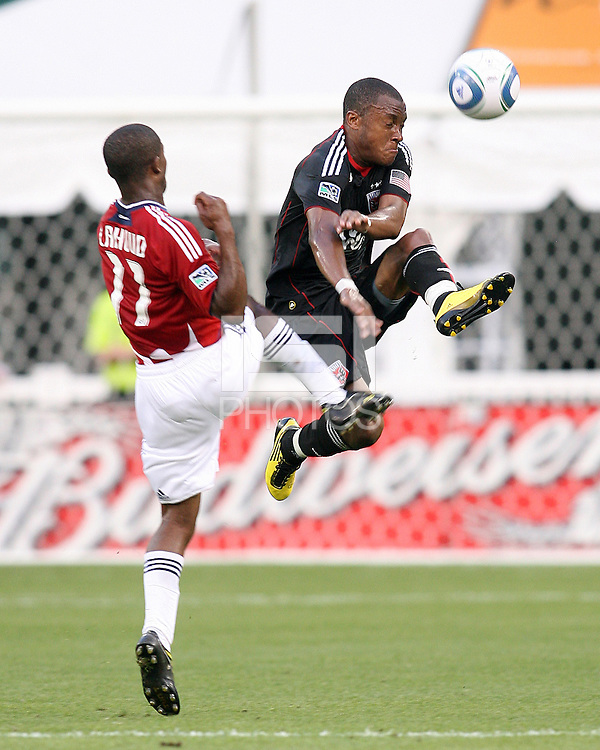 Rodney Wallace #22 of D.C. United leaps high to keep the ball away from Michael Lahoud #11 of Chivas USA during an MLS match at RFK Stadium, on May 29 2010 in Washington DC. United won 3-2.