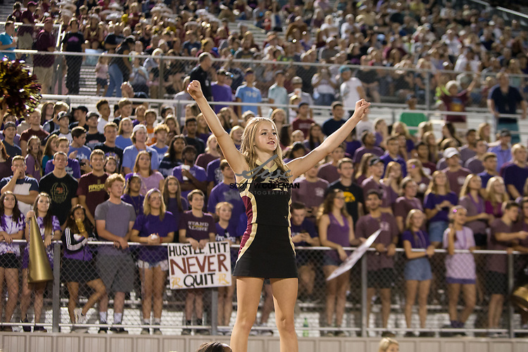 A Rouse Raiders cheerleader prepares for kickoff with the student section looking on during a high school football game between the Rouse Raiders and the East View Patriots at A.C. Bible Stadium in Leander, Texas, on Friday, September 15, 2017.