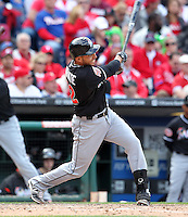 Miami Marlins second baseman Omar Infante #12 hits a solo home run in the top of the seventh inning during a game against the Philadelphia Phillies at Citizens Bank Park on April 9, 2012 in Philadelphia, Pennsylvania.  Miami defeated Philadelphia 6-2.  (Mike Janes/Four Seam Images)
