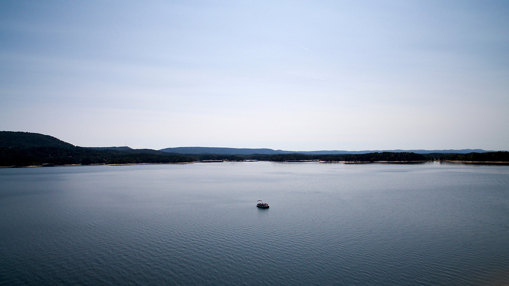 A pontoon sits in the middle of Lake Ouachita, Arkansas on Thursday, Sept. 7, 2017. (Photo by James Brosher)