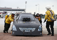 Apr 26, 2015; Baytown, TX, USA; Members of the Safety Safari push NHRA funny car driver Terry Haddock off the track during the Spring Nationals at Royal Purple Raceway. Mandatory Credit: Mark J. Rebilas-