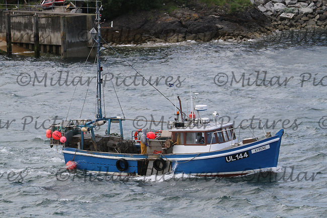 General view of the fishing boat Kyrene in Oban Harbour, Argyll & Bute taken from the MV Isle of Mull sailing from Oban to Craignure, Isle of Mull.
