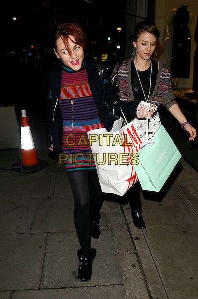 """JAIME WINSTONE .The """"H&M & Comme Des garcons"""" collection preview, H & M, Regent St., London, England..November 12th, 2008.full length black tights coat jacket bag striped stripes dress jamie blue orange red purple.CAP/CAN.©Can Nguyen/Capital Pictures."""