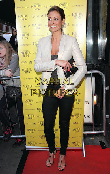 Melanie Sykes.Press Night for 'Beautiful Things' at the Arts Theatre, Leicester Square, London, England..April 17th, 2013.full length black blazer white grey gray top clutch bag.CAP/ROS.©Steve Ross/Capital Pictures
