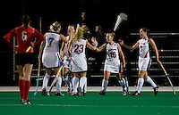 Katie O'Donnell (16) of Maryland celebrates her goal with teammates during the NCAA Field Hockey Championship semfinals in College Park, MD.  Maryland defeated Ohio State, 3-1.