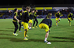 Southend United 1 Burton Albion 1, 22/02/2016. Roots Hall, League One. The visiting players going through a pre-match warm-up on the pitch at Roots Hall stadium, before Southend United took on Burton Albion in a League 1 fixture. Founded in 1906, Southend United moved into their current ground in 1955, the construction of which was funded by the club's supporters. Southend won this match by 3-1, watched by a crowd of 6503. Photo by Colin McPherson.