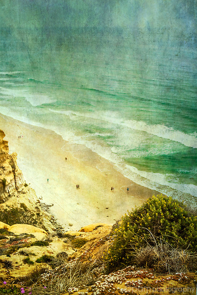 Textured image of coast with people walking on the beach