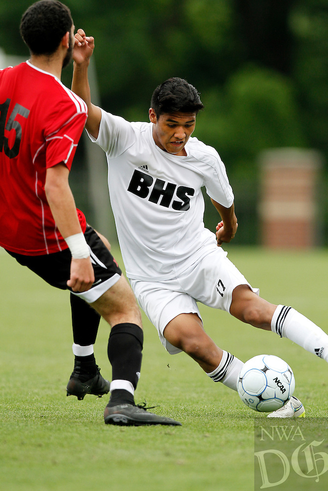 PHOTO BY SAMANTHA BAKER<br /><br />Jose Castro, right, of Bentonville attempts to maneuver the ball around Kareem Ihmeidan of Fort Smith Northside Saturday, the ball around May 23, 2014, during the 7A State Soccer championship at <br />Razorback Field in Fayetteville.