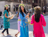 Costumed marchers bearing flower baskets representing Spring at the 11th annual Persian Parade on Madison Ave. in New York on Sunday, April 13, 2014. The parade celebrates Nowruz, New Year in the Farsi language. The holiday symbolizes the purification of the soul and dates back to the pre-Islamic religion of Zoroastrianism. (© Richard B. Levine)