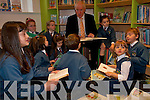 Minister Deenihan enjoying the new library facilities at Scoil Eoin Ballonagh with some of the pupils last week.