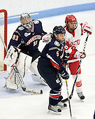 Casey Knajdek (UConn - 5), Kayla Tutino (BU - 8) - The Boston University Terriers defeated the visiting University of Connecticut Huskies 4-2 on Saturday, November 19, 2011, at Walter Brown Arena in Boston, Massachusetts.