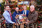 Pictured at the presentation of the Premiership 11 Christmas Competition to winner Danny Brosnan, Castlemaine, at Garveys SuperValu on Friday morning last were l-r: Chris O'Driscoll (Manager Garveys SuperValu, Tralee), Danny Brosnan (Castlemaine, winner), Tim Moynihan and Jim O'Gorman (Sports Editor Kerry's Eye Newspaper).