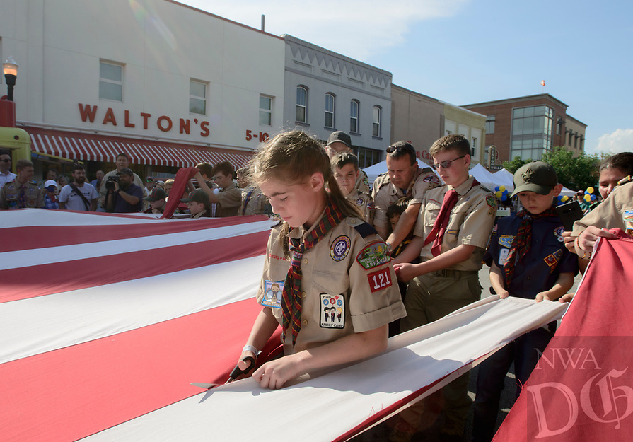 NWA Democrat-Gazette/CHARLIE KAIJO (Center) Ruby Freeman of Cub Scout pack 121 helps retire a flag during a First Friday event, Friday, July 6, 2018 at the Downtown Square in Bentonville.