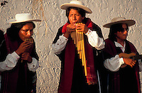 Men playing Otavalan folk music; one playing the pan flute. Ecuador.