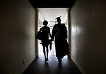 1204-40 2147<br /> <br /> 1204-40 Spring Commencement<br /> <br /> Brigham Young University Graduation<br /> <br /> Student and spouse walking in Marriott Center tunnel. Family, Holding hands, Silhouettes.<br /> <br /> April 19, 2012<br /> <br /> Photo by Jaren Wilkey/BYU<br /> <br /> &copy; BYU PHOTO 2012<br /> All Rights Reserved<br /> photo@byu.edu  (801)422-7322