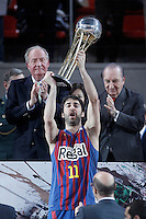 FC Barcelona Regal's captain Juan Carlos Navarro celebrates the victory in the Spanish Basketball King's Cup Final match in poresence of the King Juan Carlos I of Spain and Eduardo Portela, President of the ACB (r).February 07,2013. (ALTERPHOTOS/Acero)