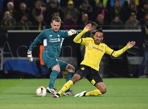 07.04.2016. Dortmund, Germany. Europa League quarterfinal. Borussia Dortmund versus Liverpool FC at the Signal Iduna Park Dortmund.   Pierre-Emerick Aubameyangchallenges Keeper Simon Mignolet (FC Liverpool)
