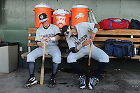 Catcher Nick McCoy (12), left and infielder Cito Culver (2) of the Charleston RiverDogs tape their bats in the dugout prior to a game against the Greenville Drive on June 3, 2012, at Fluor Field at the West End in Greenville, South Carolina. Charleston won, 5-3. Culver is the Yankees' No. 12 prospect, according to Baseball America and was a first-round draft pick in 2010. (Tom Priddy/Four Seam Images)
