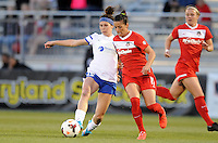 Boyds MD - April 19, 2014: Erika Tymrak (15) of FC Kansas City goes against Ali Krieger (11) of the Washington Spirit. The Washington Spirit defeated the FC Kansas City 3-1 during a regular game of the 2014 season of the National Women's Soccer League at the Maryland SoccerPlex.