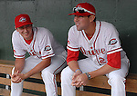 Pitcher Brandon Workman (32), left, and pitcher Anthony Ranaudo (23) of the Greenville Drive, Class A affiliate of the Boston Red Sox, wait in the dugout before the Opening Day game against the Augusta GreenJackets on April 7, 2011, at Fluor Field at the West End in Greenville, S.C. Photo by Tom Priddy / Four Seam Images