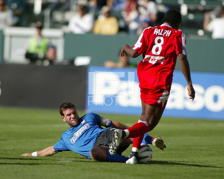 Jeff Agoos, left, slide tackles Damani Ralph, right. The San Jose Earthquakes defeated the Chicago Fire 4-2 in the MLS Cup Championships, in Carson, Calif.