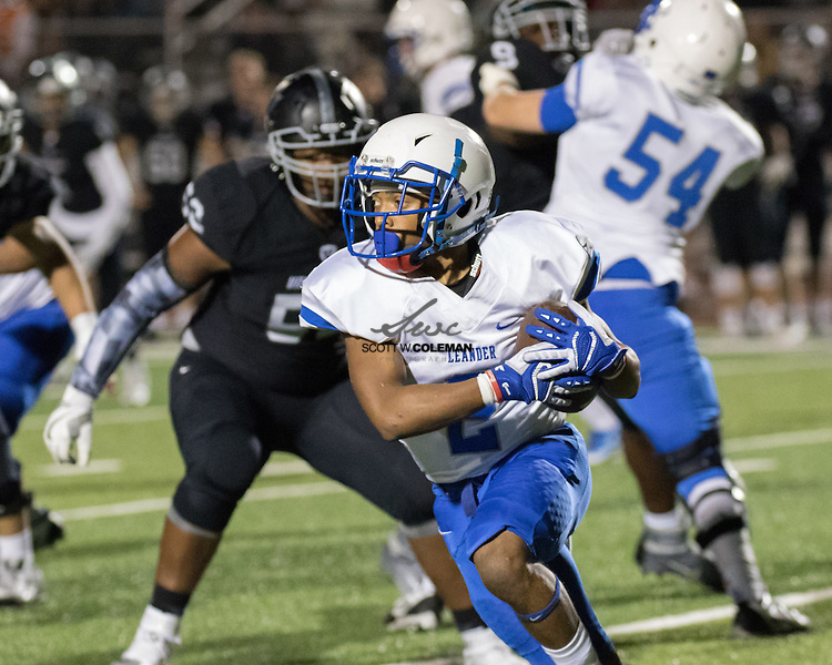 Leander Lions senior running back Jai Garcia (2) carries the ball during the first half of a high school football game between the Vandegrift Vipers and the Leander Lions at Monroe Stadium in Austin, Texas, on October 7, 2016.