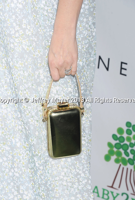 CULVER CITY, CA- NOVEMBER 09: Actress Drew Barrymore (handbag, ring detail) at the 2nd Annual Baby2Baby Gala at The Book Bindery on November 9, 2013 in Culver City, California.