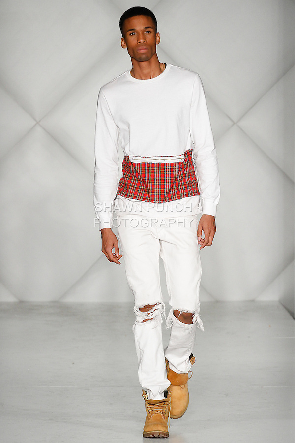 """Model walks runway in an outfit from the Royal Majesty Clothing """"Prince and the Pauper"""" collection by Malcolm Cannon, during Fashion Week Brooklyn Fall Winter 2014, Day 1 at Industry City, on March 13, 2014."""