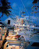 USA, Florida, man standing on fishing boat at dusk, Bud N' Mary's Marina, Islamorada