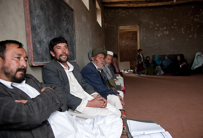 06 May 2012, Nowabad Shashpol Village, Shibar District, Bamiyan, Afghanistan: Sayed Jafar, second from left, treasurer of the village Community Development Council (CDC) of Nowabad Shaspol meeting in the community hall that was built using funds from the National Solidarity Program (NSP) as a result of the (CDC) focusing the funding they receive on solar power panels, carpet weaving and the building of the community hall. The National Solidarity Program is the Governments national flagship program to support small scale reconstruction and development activities identified by CDC's across the country.About 80% of community sub projects involve infrastructure such as irrigation, roads and electricity all critical for the recovery of the rural economy and governance.The ministry of Rural Rehabilitation and Development is implementing the program. Picture by Graham Crouch/World Bank
